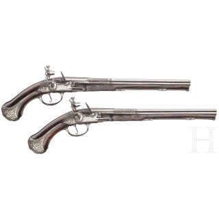 A pair of fine deluxe flintlock pistols with chiselled mounts, S. Charlet à Lyon, circa 1700