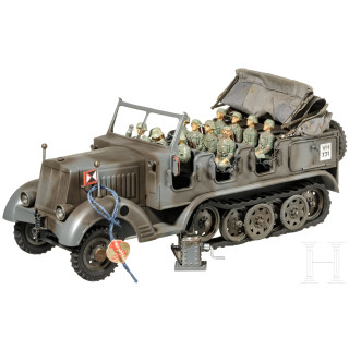 A Hausser-Elastolin WH 731 half-track vehicle in grey finish with a jack and eleven WH soldiers