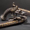 A French pair of chiselled deluxe oriental pistols for the oriental market, circa 1810/20